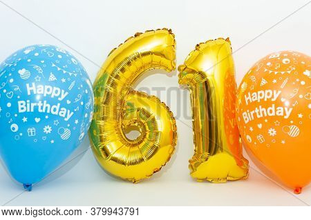 Inflatable Numeral 61 Sparkling Metallic Golden Color With Blue And Yellow Balloons Isolated On Whit