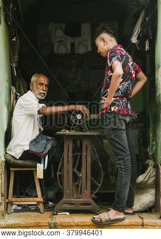 Rajasthan / India - July 25 2020 : Young Adult Man Watching And Learning Sewing From His Master, Old