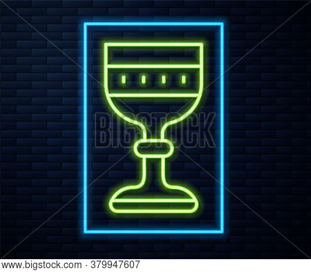 Glowing Neon Line Medieval Goblet Icon Isolated On Brick Wall Background. Vector
