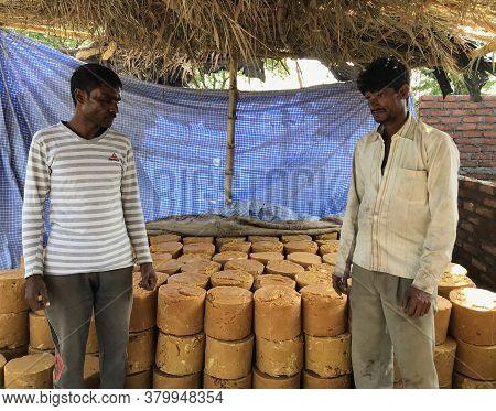 Narsinghpur, Madhya Pradesh/india : November 16, 2019 - Men Showing Jaggery Stock Made By Sugarcane