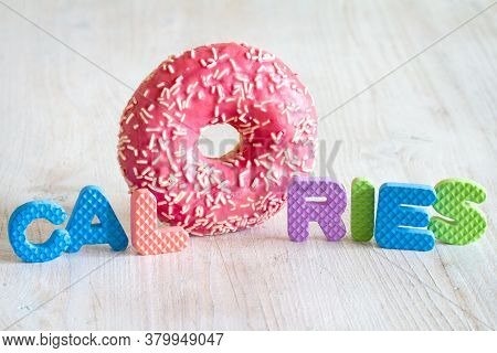 Inscription Calories With Donut Inside. Concept Calories Counting