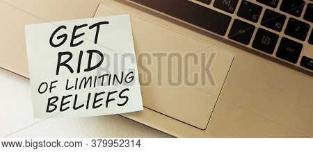 Get Rid Of Limiting Beliefs. Blank Paper Out Of A Laptop Screen, Isolated On White Background