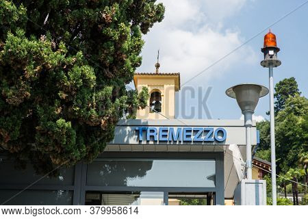Tremezzo. Lake Como. Italy - July 19, 2019: Ferry Pier in the Commune of Tremezzo. Lombardy. Signboard with Name of the City.