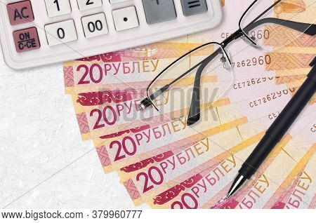 20 Belorussian Rubles Bills Fan And Calculator With Glasses And Pen. Business Loan Or Tax Payment Se