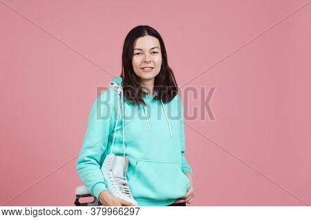 Figure Skating For Adults, Hobbies And A Healthy Lifestyle. A Young Woman In A Bright Sweatshirt Wit