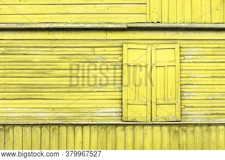 Yellow Paint Wooden Window. Closed Shutter Rustic Cottage House. Empty Copy Space Wood Wall. Country