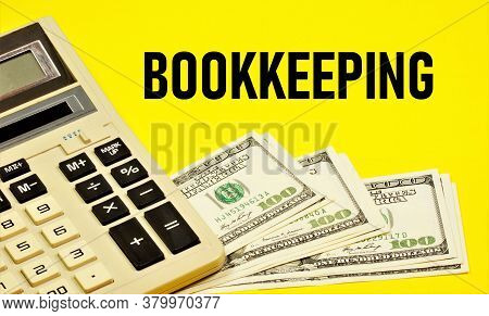 Bookkeeping - Text Inscription On The Background Of Money And A Calculator. Development Of The Organ