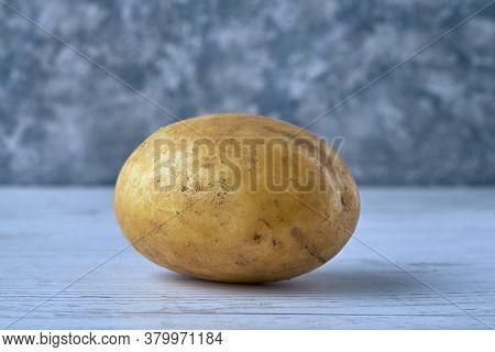 Fresh Raw Potato On Textured Background