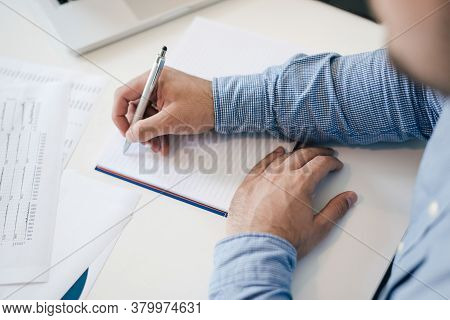 Man Holding Pen Pencil In Hand Filling Writing Taking Notes Into Notes Starting New Chapter Business