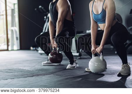 Sporty Team With Kettlebells And Exercise Workout At Fitness Gym With Personal Trainer Coaching, Spo