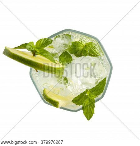 Top View Of Mojito Cocktail With Lots Of Ice, White Rum, Lemon Juice And Tonic, Decorated With Lime
