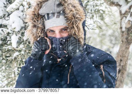 Gazi Antep, Turkey 18 Desember 2019:\na Handsome Man Wears A Warm Scarf Wrapped Around His Neck Whil