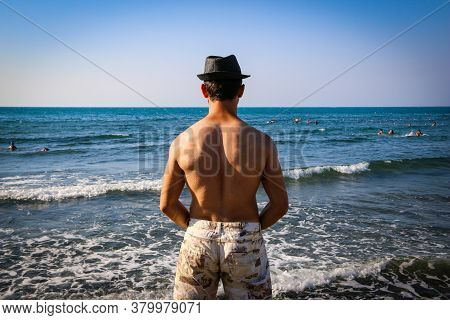 Stanbul, Turkey 02 March 2019:\na Young Man Wearing A Hat Turns His Back On The Sea