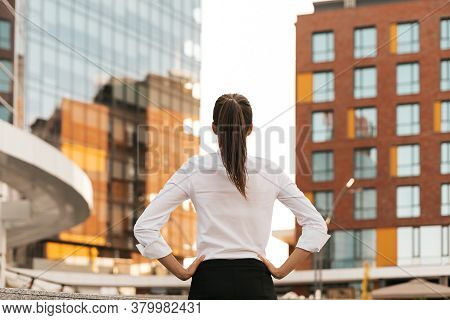 Successful Woman Watching Confidently Her Target. Back View Of Determined Woman Looking To Big Busin