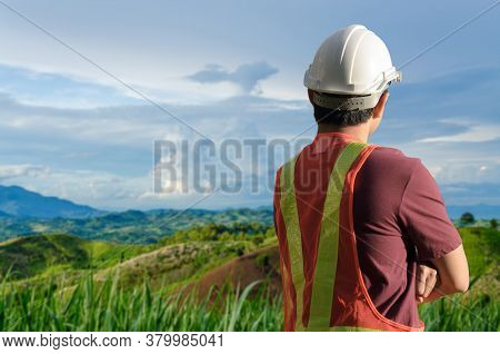 Technical Surveyor Stood And Looked At The Work Site.