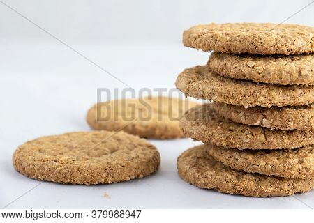 Homemade Shortbread Cookies Made Of Oatmeal Are Stacked On A White Table Background. Food Snack Conc