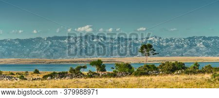 View From The Island Of Vir In Croatia To Pag Island And Velebit Mountains In The Background.