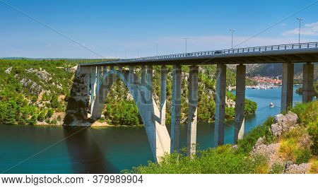 Sibenik Bridge Across Canyon Of The Krka River. Panoramic View Towards Scradin Town Far Upstream