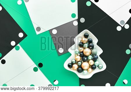Abstract Christmas Background With Baubles In Plate With Xmas Tree Silhouette On Multicolor Layered