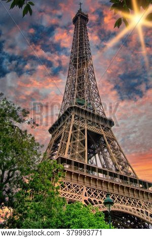 Eiffel tower in Paris at sunset in a bright summer day