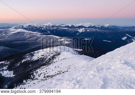 View Of Snow-capped Mountains Topped With Colorful Sunrise Sky