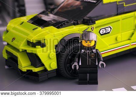 Tambov, Russian Federation - June 24, 2020 Lego Lamborghini Urus St-x Driver Minifigure Near Her Car