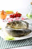 Sea Bass with olive oil and lemon on complex background poster