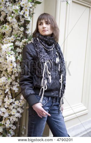 Young Attractive Woman Standing At Flower In State Department Store. Moscow