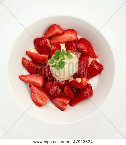 Flambe strawberries with ice cream shot from above