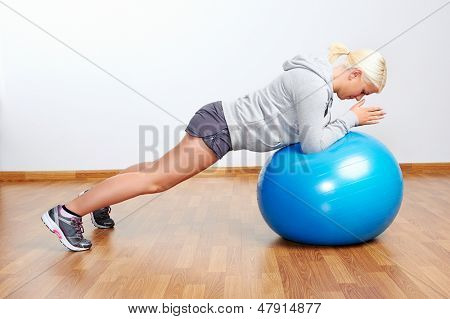 pilates ball fitness workout woman in gym