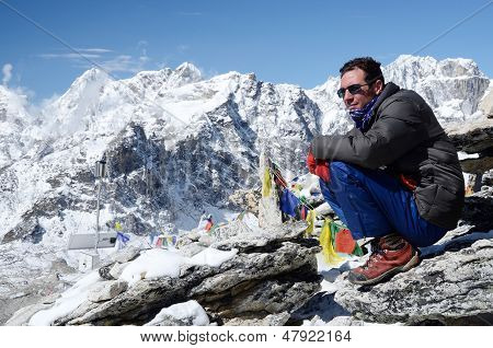 Climber sitting at the foot of Kala Patthar mountain,Nepal
