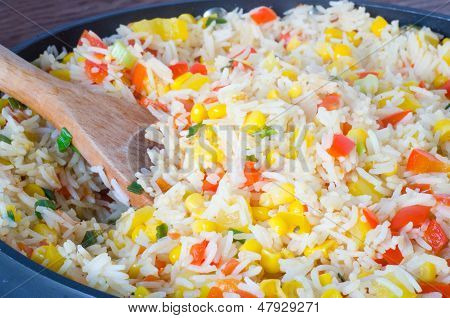 Rice salad with corn and vegetables