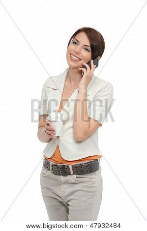 Beautiful Woman Talking On Her Mobile And Holding A Take Away Coffee