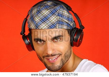 30 Years Old Man With Beret And Earphones