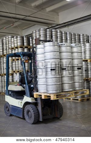 MOSCOW - OCT 16: Autoloader loading beer kegs in warehouse brewery Ochakovo on Oct 16, 2012, Moscow, Russia. Ochakovo is largest Russian company beer and soft drinks industry without foreign capital.