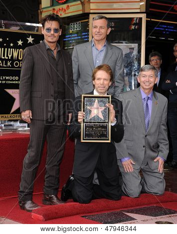 LOS ANGELES - JUN 23:  Johnny Depp, Jerry Bruckheimer, Robert Iger & LeRon Gubler arrives to the Walk of Fame Honors Jerry Bruckheimer  on June 23, 2013 in Hollywood, CA