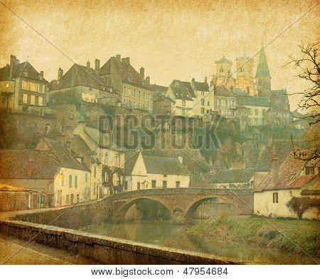 Semur-en-Auxois. Burgundy, France. Photo in retro style. Paper texture.