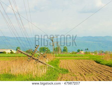 Fallen Telephone Poles On The Field