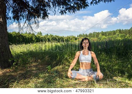 Young Woman Doing Yoga Outdoor
