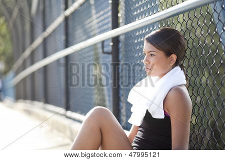 Young Athlete Sitting Resting And Thinking