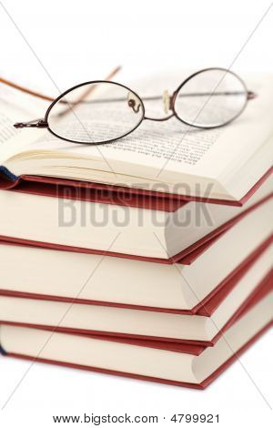 Pile Of Books With Glasses Isolated