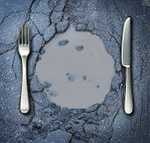 Poverty and hunger concept with a fork and knife on a broken asphalt road shaped as a dinner plate as a social problem of food shortage hardships caused by financial distress or natural disaster resulting in living poor on the streets as a health risk. poster