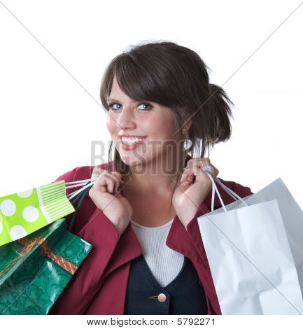 Young woman with shopping bags; isolated on white