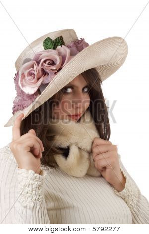 Young woman wearing a fancy mauve and cream organdy hat
