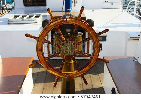 Ship steering wheel and navigation compass