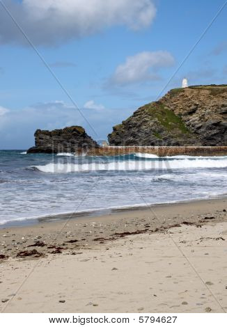 Waves Reaching The Beach In Portreath, Cornwall Uk.