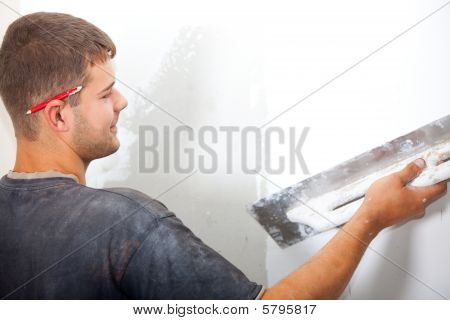 Man plastering the wall