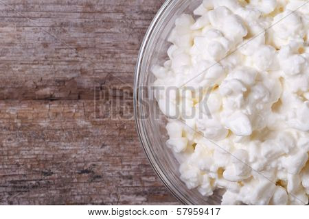 Cottage Cheese In A Glass Bowl Macro. View From Above. Horizontal