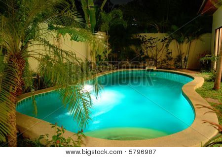 Night Swimming Pool In Tropical Garden