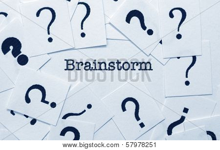 Close up of Brainstorm text with questionmarks poster